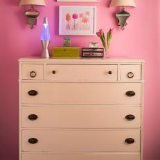 Pretty in Pink Girl's Room With White Dresser