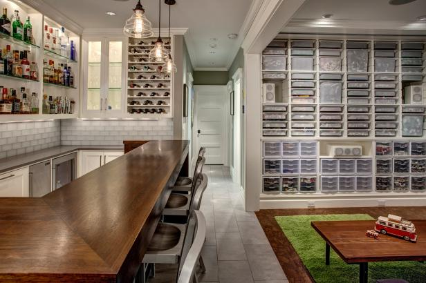 Chic Basement Bar Adjacent to Well-Organized Playroom