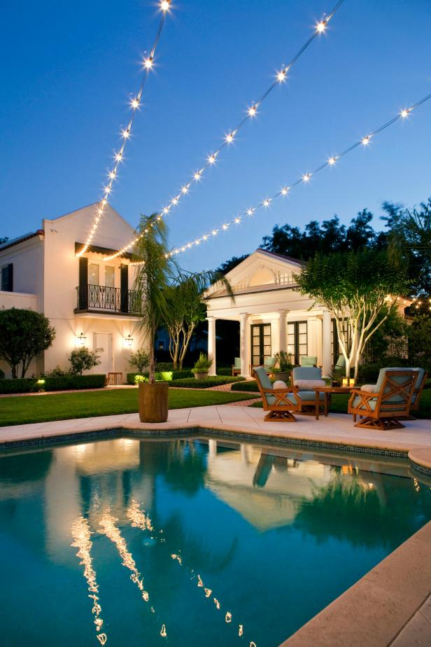 Traditional Pool With Poolhouse and Twinkly Outdoor Lighting