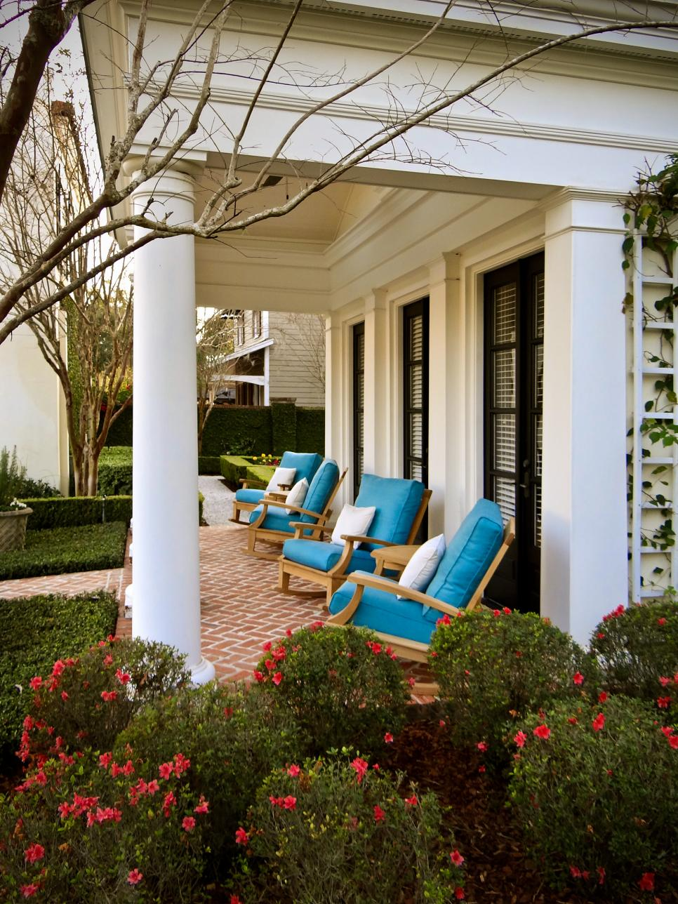 Wood Chairs With Blue Cushions on Traditional Porch