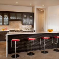Modern Kitchen with Glass-front Cabinets and Wavy Wood Kitchen Island