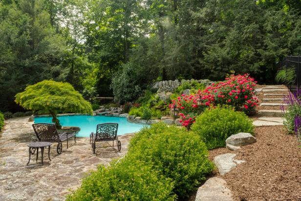 Traditional Landscaped Pool at Tudor-Style Home