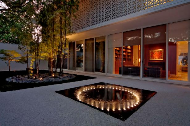 Contemporary Courtyard With Water Feature, Trees, Rock Bed