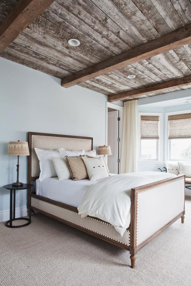 Blue Country Bedroom With Beige Upholstered Bed