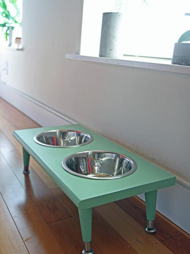 Make a pet feeding station using a wooden stair tread.