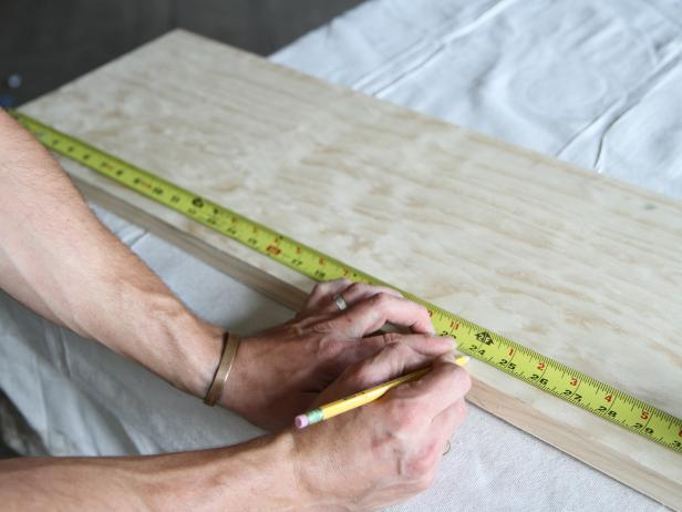 "Measure and mark the wood stair tread at 24"" with a pencil."