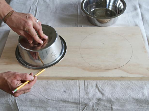 Trace each bowl onto the wood using a pencil
