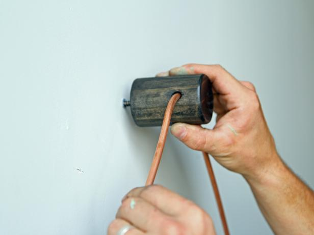 Install the piece on the wall by twisting the dowel screw into a stud or a drywall anchor.