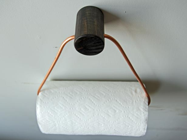 Add a stylish touch to your kitchen with a DIY copper paper towel holder.