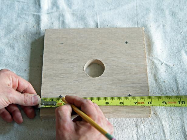 "Measure and mark 1 1/2"" from each corner on each side, making a plus sign in all four corners"