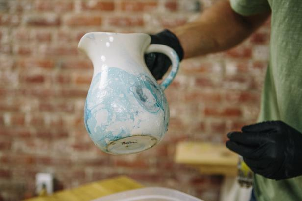 Create a marbling effect on vases using nail polish.