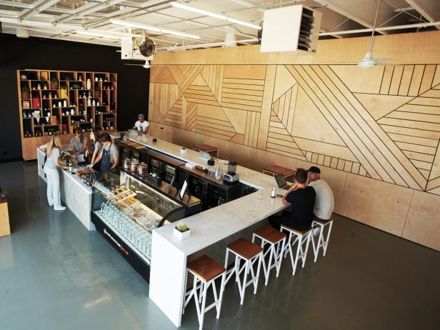 Interior of Contemporary Juice Bar With Large Bar and Wood Accent Wall