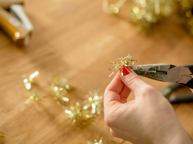 If you're using tinsel wire, use wire cutters to snip into small pieces, then use needle nose pliers to bend each section into a ball shape so that it stands up well inside the ornament.