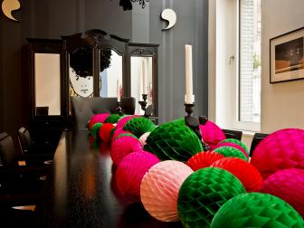 Black Dining Room Decorated for Christmas With Pink, Green and Red Paper Balls