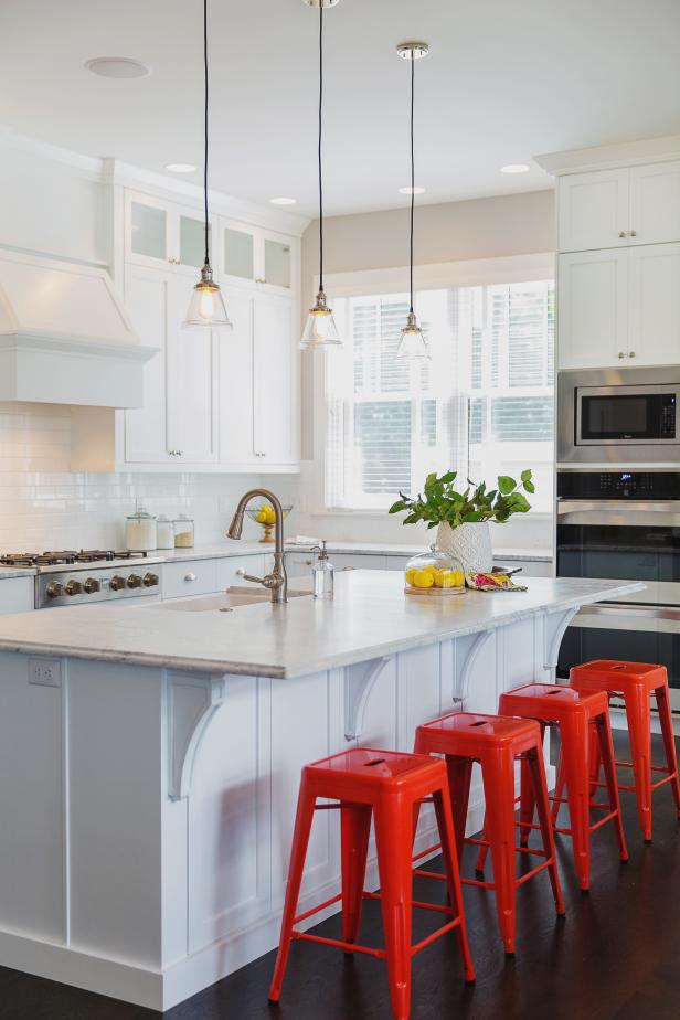 White Kitchen With Red Barstools