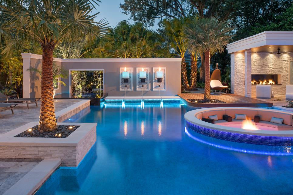 Tropical pool with sunken fire pit seating area hgtv for Design your own inground pool
