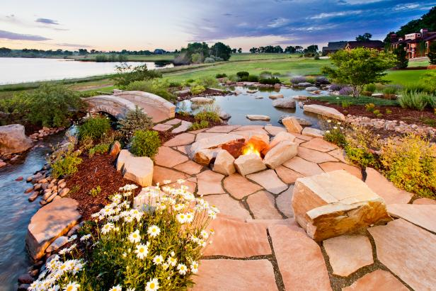 A Circular Stone Fire Pit With a Lake View