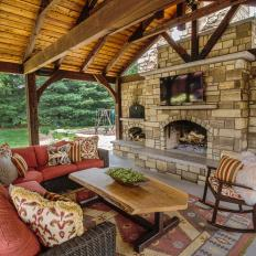 Cozy Up by the Outdoor Fireplace and Watch TV