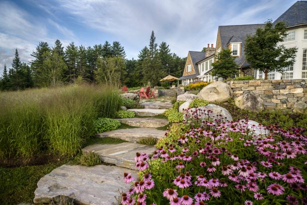 Pastoral Backyard with Stone Stairs and Walls