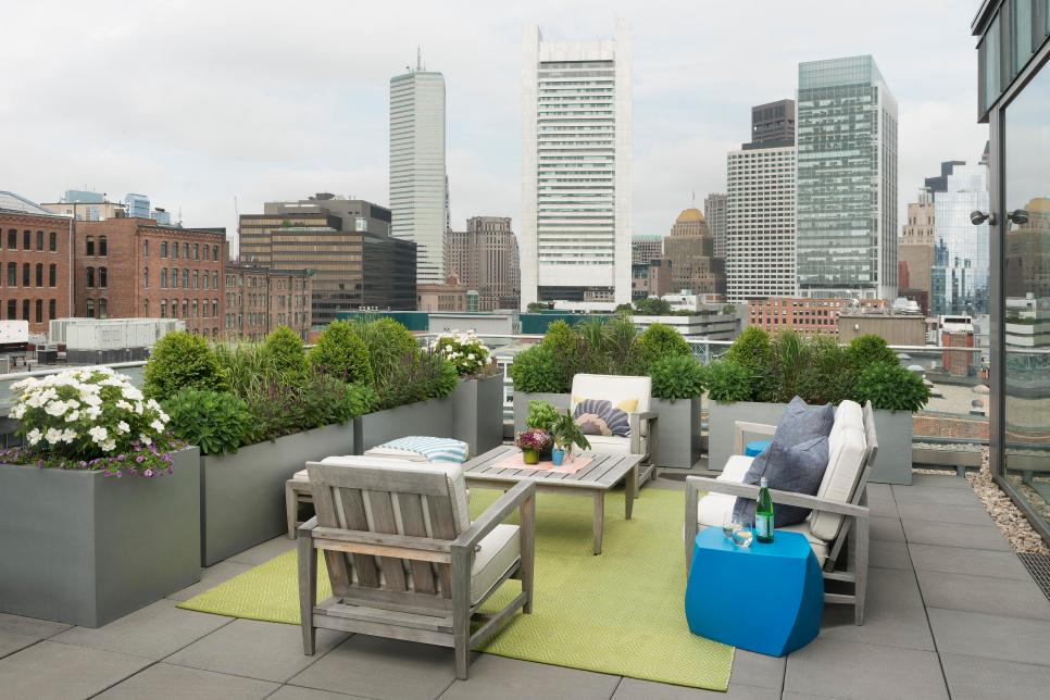 Modern Rooftop Outdoor Lounge Area with City Skyline Views