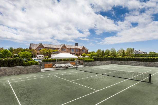 Personal Tennis Court With Stone Retaining Wall and Shaded Sectional