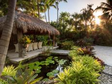 Tropical Landscape Design with a Water Feature, Bridge and Hut