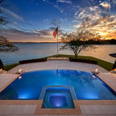 Lakeside Patio Swimming Pool With Negative Edge, Fire Pit Accents and Underwater Lighting