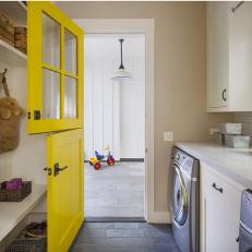 Modern Farmhouse Laundry Room with Yellow Door