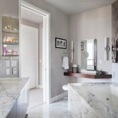 Modern Master Bathroom Features Luxurious Marble & Floating Dressing Table