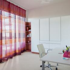 Modern Office Features Clean Lines, Sleek Storage & Bright Window Treatment
