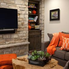 Contemporary Living Room With Stacked Stone Statement Wall
