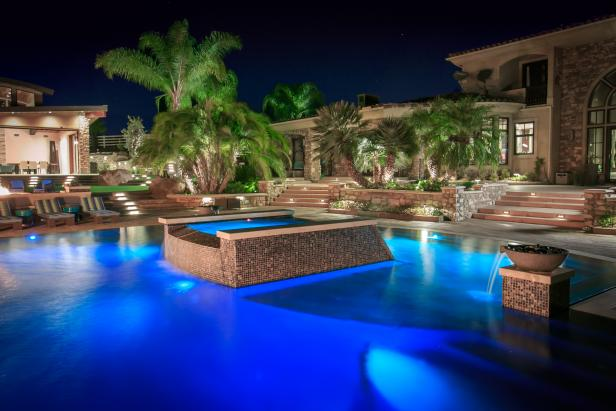 Tropical Pool Oasis With Water Features And Fire Pit