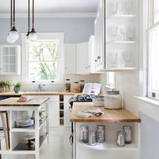 Beautiful White Kitchen With Island And Open Corner Shelving Photos Hgtv