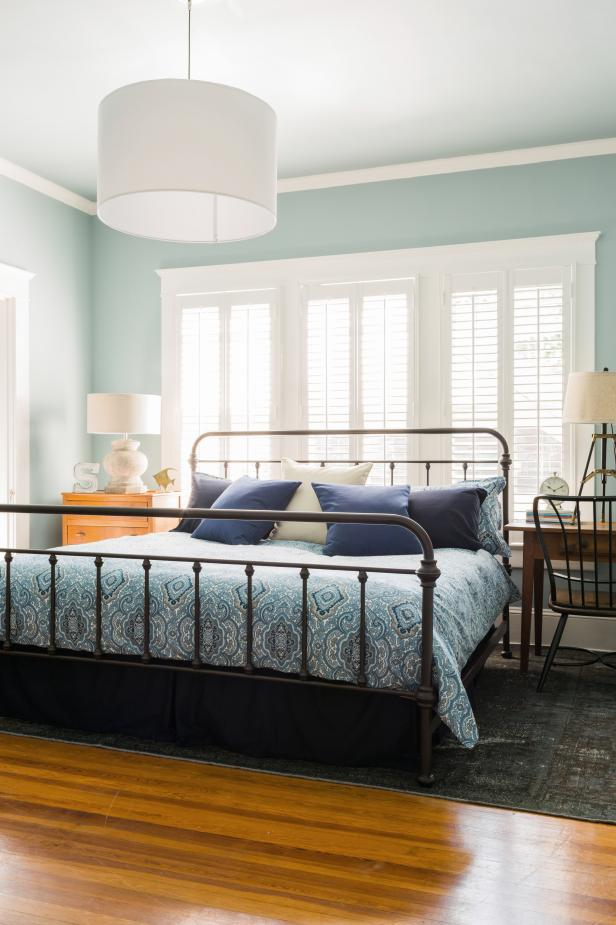 Blue Bedroom With White Pendant Light And Plantation