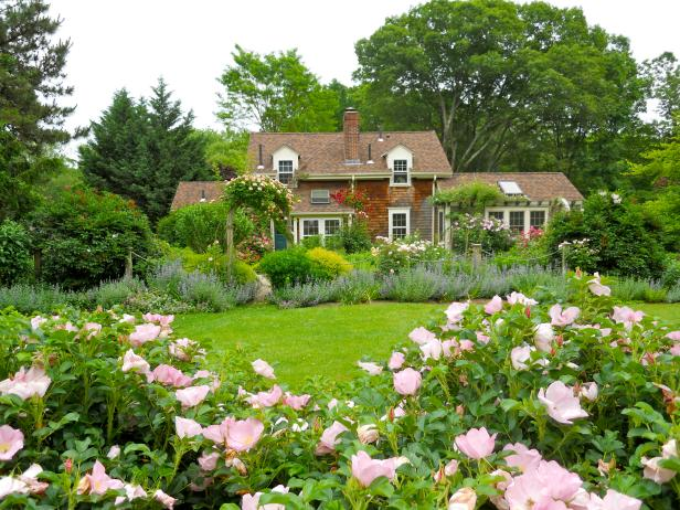 A formal cottage garden with a large lawn