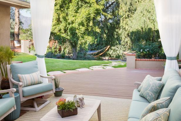 A wood patio with lounge furniture