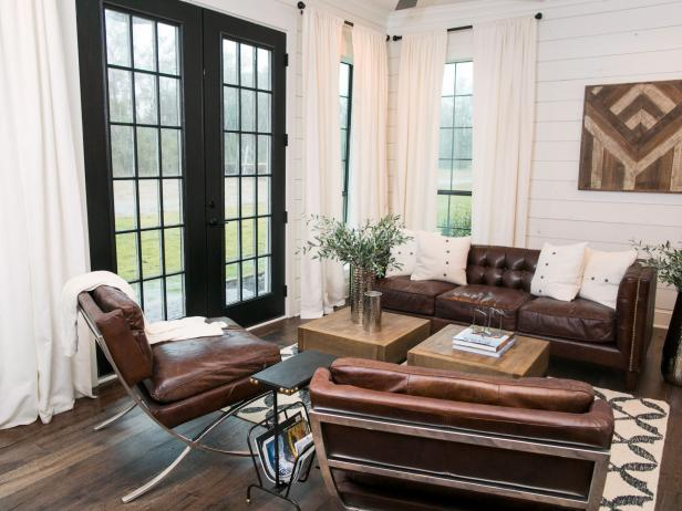 Living Room with Leather Seating, French Doors and Custom Wall Art
