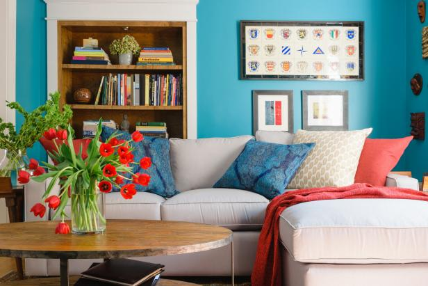 Blue Living Room With Built-In Bookcase and Framed Art