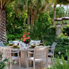 Outdoor Dining Table Under Palm Trees