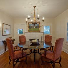 Traditional Dining Room With Victorian Upholstered Chairs, Polished Wood Table and Chandelier