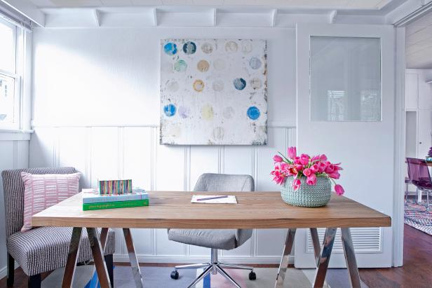White Home Office With Wood Desk and Blue Polka Dot Painting