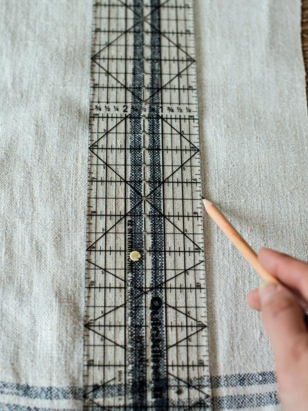 "Measure and cut four 18"" x 4"" pieces of fabric out of tablecloth or ticking remnant."
