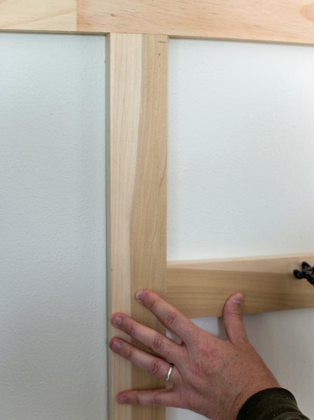 "Cut 1"" x 4"" boards to 14"" long to use as rails.  Use 14"" ""measuring stick"" to measure between top rail and lower rail to form a 14"" square pattern.  Once properly placed and level, nail into place with finishing nails to secure."