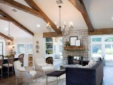 Open Concept Living Room With Exposed Beam Vaulted Ceilings