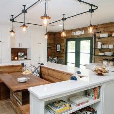 Natural Wood Country Kitchen With Built In Dining Room And Track Lighting