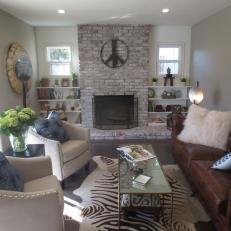 Contemporary Living Room With Brick Fireplace Surround, Brown Leather Tufted Couch and Nailhead Trim Neutral Chairs