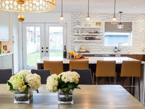 Bright eat in kitchen and dining room featuring gray and white backsplash mustard yellow bar