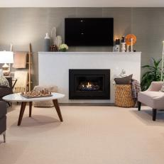 Structured White Fireplace Surround, Mantel Mounted Television and Neutral Furniture in Midcentury Modern Living Room