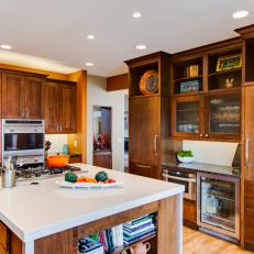 Brown Kitchen With White Center Island