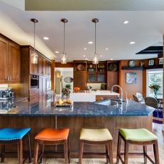 Open Plan Neutral Kitchen With Multicolored Barstools